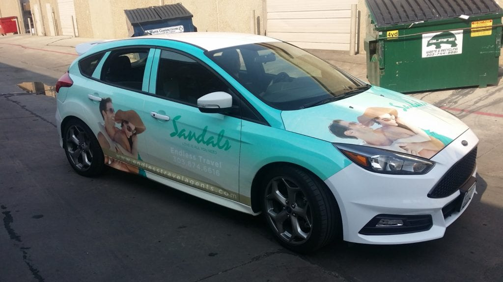Small Car with Custom Vehicle Wrap